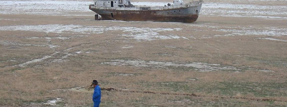 A grounded fishing boat on the floor of the Aral Sea.